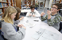 NWA Democrat-Gazette/DAVID GOTTSCHALK Olivia Whitney (from left), Sophia Shepherd, Wynter (cq) Clampit and Dylan Steinhour, eighth grade honor students at Central Junior High School, work on a weaving project for a print shop Monday, December 3, 2018, during the Moncrief Game Changer Entrepreneurship Summit at the school in Springdale. The summit, sponsored by the Schmieding Foundation, featured workshops that included written expression, sales skills and first impression development.