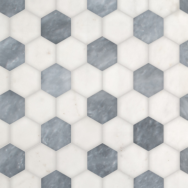 Hex, a waterjet stone mosaic, shown in polished Afyon White and Allure, is part of the Semplice® collection for New Ravenna.