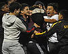 Uniondale fans mob their varsity boys soccer team after its win in penalty kicks over Farmingdale in the Nassau County Class AA semifinals at Hofstra University on Thursday, Oct. 27, 2017. The game went to the penalty kick portion after a scoreless tie that lasted regulation and two 15-minute overtime periods.