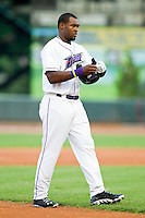 Courtney Hawkins (10) of the Winston-Salem Dash takes off his helmet and batting gloves after having been left on base during the Carolina League game against the Lynchburg Hillcats at BB&T Ballpark on August 5, 2013 in Winston-Salem, North Carolina.  The Dash defeated the Hillcats 5-0.  (Brian Westerholt/Four Seam Images)