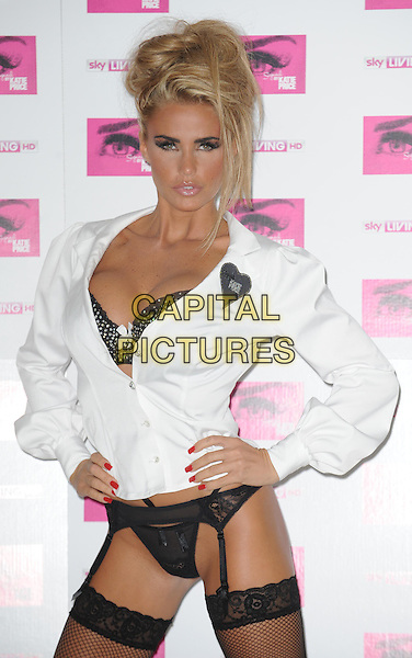 Katie Price (aka Jordan).promotes her new Sky Living series 'Signed By Katie Price' at The Worx, London, England 10th October 2011.half length white shirt unbuttoned bra black cleavage hands on hips hold ups garter belt stockings fishnet lace red nail varnish polish silver heart badge.CAP/WIZ.© Wizard/Capital Pictures.