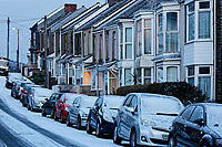 "Pictured: Snow covered houses and cars in Rhondda Street in the Mount Pleasant area of Swansea, caused by the ""Beast from the East"", south Wales, UK. Wednesday 28 February 2018<br /> Re: Strong cold winds from the east have been affecting most parts of the UK with temperatures in some parts below zero."