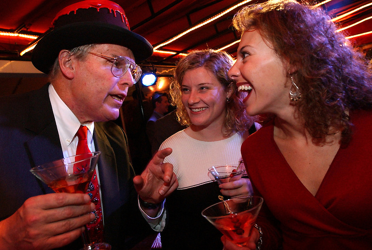 Bill Samuels, of Maker's Mark bourbon, chats with Christine Roth, center, of the Education and Workforce Committee, and Shahira Knight of the House Ways and Means Committee, at a Holiday Wine and Spirits Reception held by Allied Domecq.  The recepiton was held Thursday at the Sewell Belmont House and Samuels, 7th generation distiller of the bourbon out of Loretta, Kentucky,  was on hand to autograph special bottles of Makers Mark, hand dipped in black wax, at the party.