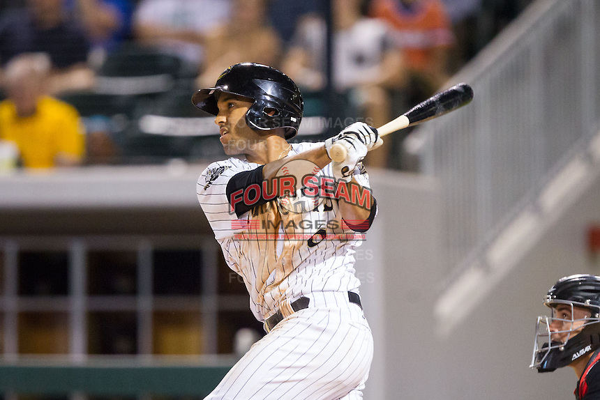 Marcus Semien (6) of the Charlotte Knights follows through on his swing against the Rochester Red Wings at BB&T Ballpark on June 5, 2014 in Charlotte, North Carolina.  The Knights defeated the Red Wings 7-6.  (Brian Westerholt/Four Seam Images)