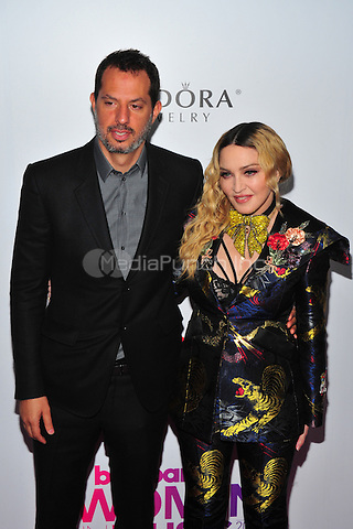 NEW YORK, NY - DECEMBER 9 : Madonna and Guy Oseary at the 11th Annual Billboard's Women In Music Luncheon at Madison Square Garden in New York City on December 9, 2016. Credit: John Palmer/MediaPunch