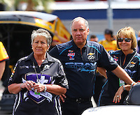 Apr 10, 2015; Las Vegas, NV, USA; NHRA sponsor Terry Chandler (left), brother Johnny Gray (center) and his wife Terry Gray during qualifying for the Summitracing.com Nationals at The Strip at Las Vegas Motor Speedway. Mandatory Credit: Mark J. Rebilas-