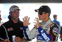 Nov. 20, 2009; Homestead, FL, USA; NASCAR Sprint Cup Series driver Jimmie Johnson (right) talks with crew chief Chad Knaus during practice for the Ford 400 at Homestead Miami Speedway. Mandatory Credit: Mark J. Rebilas-
