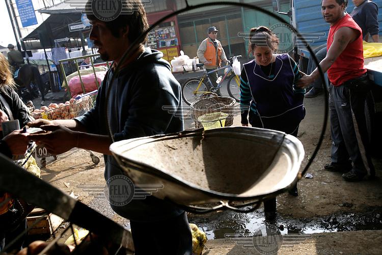 Stall holders at the La Vega Central market.