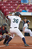 Cedar Rapids Kernels first baseman D.J. Hicks #36 bats during a game against the Lansing Lugnuts at Veterans Memorial Stadium on April 29, 2013 in Cedar Rapids, Iowa. (Brace Hemmelgarn/Four Seam Images)