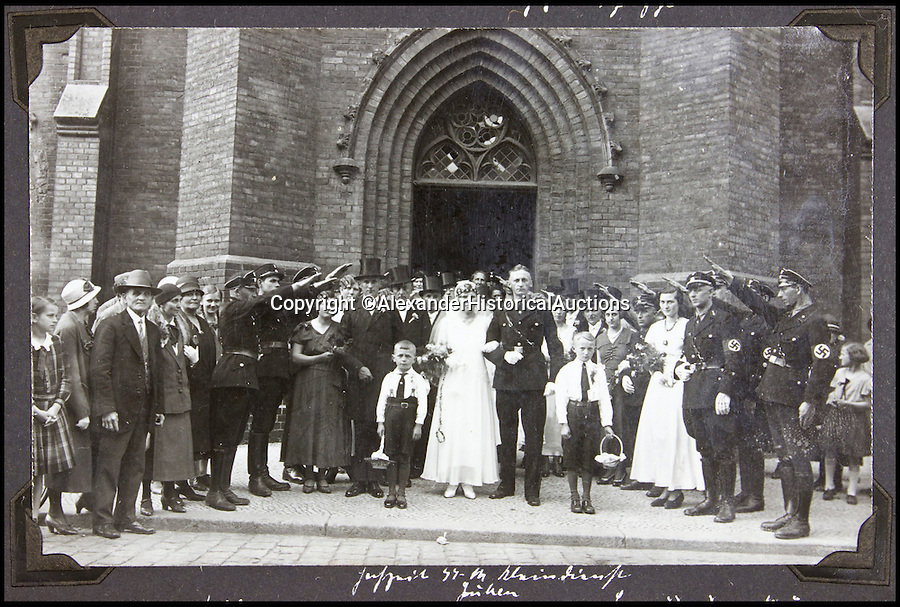 BNPS.co.uk (01202 558833)<br /> Pic: AlexanderHistoricalAuctions/BNPS<br /> <br /> A SS officer recieves the Nazi salute from other members on his wedding day.<br />  <br /> Chilling early photographs of the Nazi party which show Adolf Hitler basking in the adulation of his fanatical supporters and Jews being persecuted have been unearthed.<br /> <br /> The disturbing images from an SS officer's photo album date from 1931 to 1935 so they cover the period of the Nazis' rise to power and the first two years of the dictatorship.<br /> <br /> The album was recovered by US Army officer Philips Parks Ramsey after the war but his family have now decided to put it up for auction and it is tipped to sell for £1,500 ($2,000).