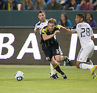 Columbus Crew midfielder Eddie Gaven (12) battles Galaxy defender Sean Franklin (28) for the ball during the first half of the game between LA Galaxy and the Columbus Crew at the Home Depot Center in Carson, CA, on September 11, 2010. LA Galaxy 3, Columbus Crew 1.