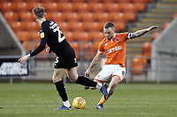 Blackpool's Jay Spearing hits a long pass despite the attentions of Barnsley's Cauley Woodrow<br /> <br /> Photographer Rich Linley/CameraSport<br /> <br /> The EFL Sky Bet League One - Blackpool v Barnsley - Saturday 22nd December 2018 - Bloomfield Road - Blackpool<br /> <br /> World Copyright &copy; 2018 CameraSport. All rights reserved. 43 Linden Ave. Countesthorpe. Leicester. England. LE8 5PG - Tel: +44 (0) 116 277 4147 - admin@camerasport.com - www.camerasport.com