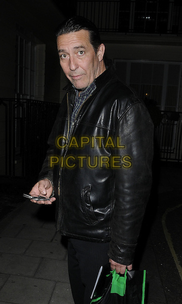 "Ciaran Hinds.Seen leaving after watching the evening performance of ""Flare Path"", Theatre Royal Haymarket, London, England, UK, June 9th 2011..half  length black leather jacket  brown shoes bag trousers phone .CAP/CAN.©Can Nguyen/Capital Pictures."