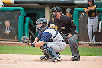 Colorado Springs Sky Sox catcher Nevin Ashley (31) sets a target as home plate umpire Greg Stanzak looks on during the Pacific Coast League game against the Salt Lake Bees at Smith's Ballpark on May 22, 2015 in Salt Lake City, Utah.  (Stephen Smith/Four Seam Images)