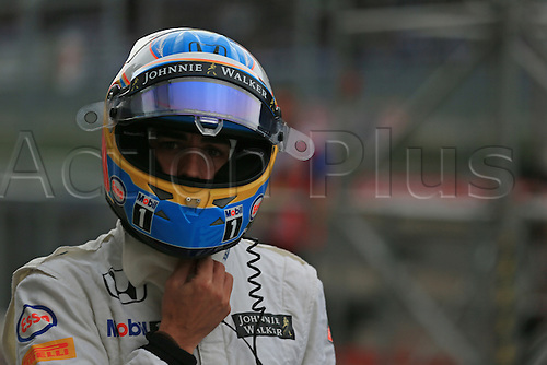 20.06.2015.  Red Bull Ring, Spielberg, Austria. F1 Grand Prix of Austria.   Fernando Alonso of McLaren Honda car stopped on the start/finish staight and he had to walk back to garage while his crew pushed his car back