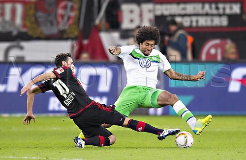 01.04.2016. Leverkusen, Germay. Bundesliga football. Bayer Leverkusen versus VFL Wolfsburg in the BayArena in Leverkusen.  Hakan Calhanoglu Bayer Dante Wolfsburg