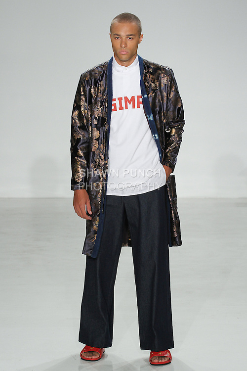 Model walks runway in a Spanish silk double tie cardigan, white cotton popover, SIMP tee and Japanese denim wide leg trouser, from the Palmiers du Mal Spring Summer 2017 collection by Brandon Capps and Shane Fonner, at Skylight Clarkson Square on July 14 2016, during New York Fashion Week Men's Spring Summer 2017.