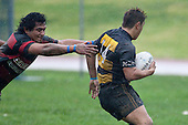 Josh Panapa tries to evade the reach of Stephen Lauhingoa. Counties Manukau Premier Club Rugby game between Papakura & Bombay played at Massey Park Papakura on Saturday May 30th 2009..Bombay won 57 - 7 after leading 24 - 0 at halftime.
