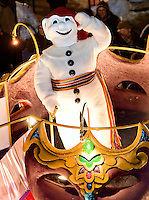 Standing on a float, Bonhomme Carnaval, mascot of the Carnaval de Quebec, salutes the crowd at the Quebec Winter Carnival parade Saturday, Feb. 14, 2009 in Quebec city. The festival typically starts on the last Friday of January or the first Friday of February and continues for 17 days. With close to one million participants, it has grown to become the largest winter celebration in the world