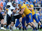 BROOKINGS, SD - SEPTEMBER 20:  Jack Sherlock #36 from South Dakota State wraps up Manfred Johnson #2 from Wisconsin-Oshkosh in the first half of their game Saturday at Coughlin Alumni Stadium in Brookings. (Photo/Dave Eggen/Inertia)