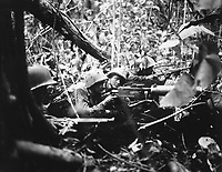 Retreating at first into the jungle of Cape Gloucester, Japanese soldiers finally gathered strength and counterattacked their Marine pursuers.  These machine gunners pushed them back.  January 1944.  Brenner. (Marine Corps)<br /> Exact Date Shot Unknown<br /> NARA FILE #:  127-N-71981<br /> WAR &amp; CONFLICT BOOK #:  1186