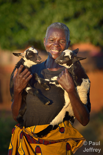 Ennis Theu holds goats she raises as a participant in a Building Sustainable Livelihoods program in Kaluhoro, Malawi. With support from the Ekwendeni Hospital AIDS Program, villagers work together to earn and save money, raise more nutritious food, and receive vocational training.