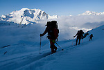 A group of skiers climb above the Valsorey Hut while touring the classic Haute Route, Switzerland.