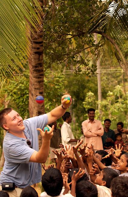 A man juggle to entertain school children in the Kalrayan Hills in Tamil Nadu, India