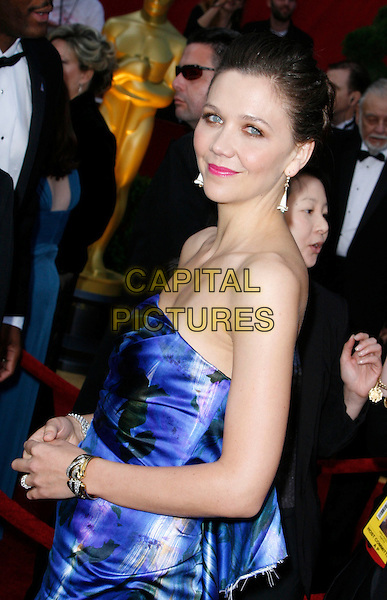 MAGGIE GYLLENHAAL.The 82nd Annual Academy Awards held aat The Kodak Theatre in Hollywood, California, USA..March 7th, 2010.oscars half length strapless blue print patterned pattern printed dress white side.CAP/EAST.©Eastman/Capital Pictures.
