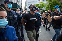NEW YORK, NEW YORK - MAY 29: A Protester is arrested in the protest against the police in response to the police officer who killed George Floyd in Minneapilis in front of the Manhattan court on May 29, 2020 in New York. Across the country, protests against Floyd's death have sparked movements day and night. (Photo by Pablo Monsalve / VIEWpress via Getty Images)