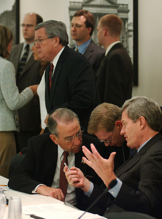 9/29/04.CORPORATE TAX CONFERENCE--House Ways and Means Chairman Bill Thomas, R-Calif., background standing, and Senate Finance Chairman Charles E. Grassley, R-Iowa, and ranking Democrat Max Baucus, D-Mont., before the joint House-Senate conference on the corporate tax bill..CONGRESSIONAL QUARTERLY PHOTO BY SCOTT J. FERRELL
