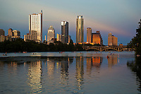 Beautiful Sunset  falls on the Austin Skyline as water enthusiast kayak and canoe on Lake Austin