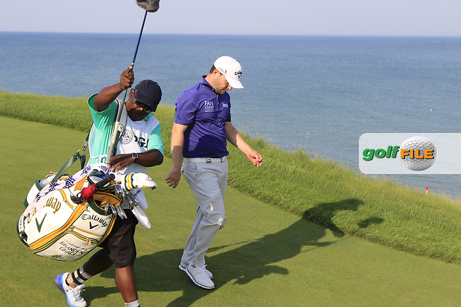 Branden GRACE (RSA) and caddy Zack Rasego walk off the 16th tee during Sunday's Final Round of the 97th US PGA Championship 2015 held at Whistling Straits, Mosel, Kohler, Wisconsin, United States of America. 16/08/2015.<br /> Picture Eoin Clarke, www.golffile.ie