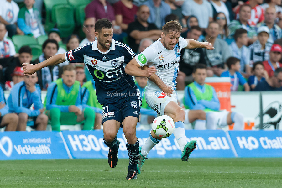 Carl VALERI of the Victory and Jacob MELLING of Melbourne City fight for the ball in round 11 A-League match between Melbourne City and Melbourne Victory at AAMI Park in Melbourne, Australia during the 2014/2015 Australian A-League season. City def Victory 1-0