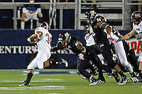 25 October 2011:  FIU defensive lineman James Jones (94) tackles Troy running back D.J. Taylor (31) in the first quarter as the FIU Golden Panthers defeated the Troy University Trojans, 23-20 in overtime, at FIU Stadium in Miami, Florida.