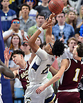 UNCASSVILLE, CT-031818JS06- Sacred Heart's Zachary Francisco (33) is called for a foul while defending Notre Dame-Fairfield's Noreaga Davis (20) during their Division I championship game Sunday at Mohegan Sun Arena. <br /> Jim Shannon Republican-American