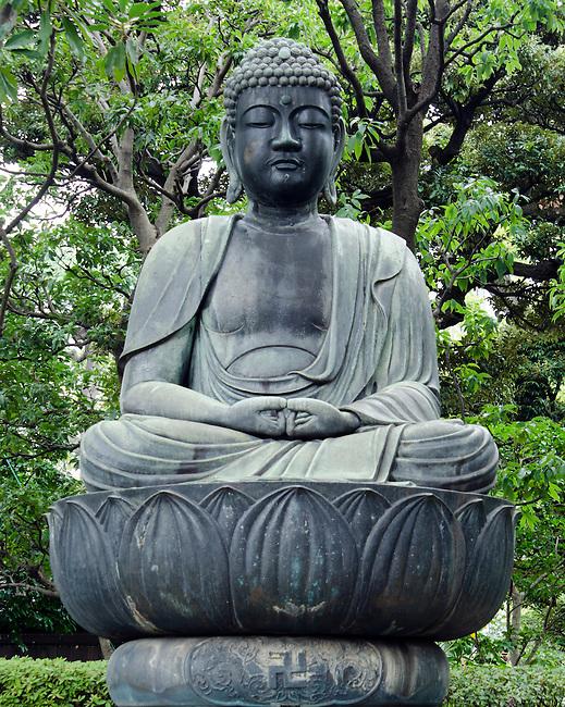 Japanese Buddha statue sitting on lotus blossom