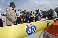 NWA Democrat-Gazette/FLIP PUTTHOFF <br />Elected officials and highway department officials gather Wednesday May 10 2017 to cut a ribbon dedicating a section of the Bella Vista bypass. The route is planned to eventually be part of Interstate 49.