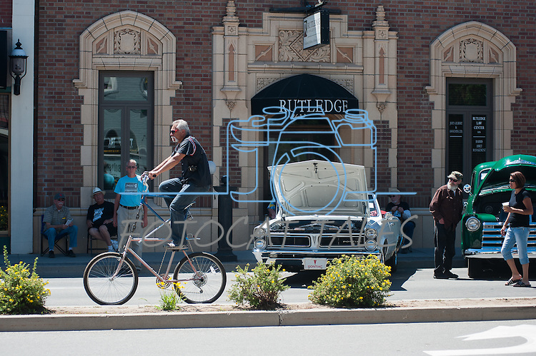 A spectator rides his tall bike during Legends of the West in Carson City, Nev., on Saturday June 22, 2013.<br /> (Photo by Kevin Clifford/Nevada Photo Source)