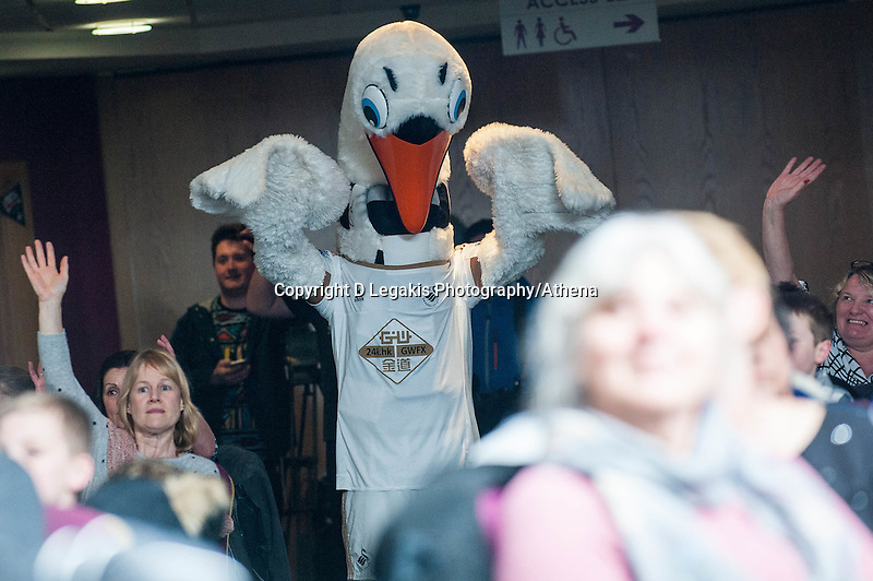 Friday  25 March 2016<br /> Pictured: Cyril the Swan<br /> Re: Pen y Bryn Special school  launch their Swansea City FC book at the Liberty Stadium, Swansea, Wales, UK