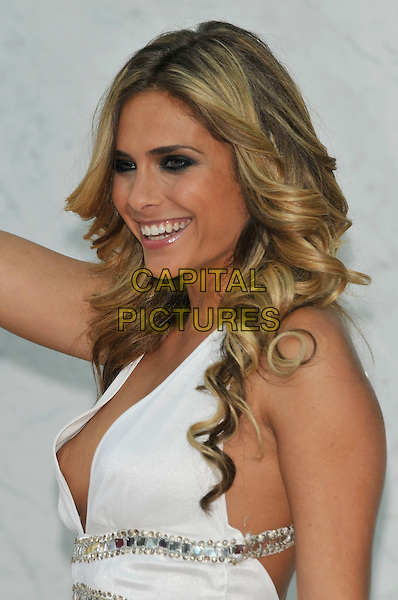 CLARA MORGANE.World Music Awards 2010 at the Sporting Club Monte Carlo, Monaco.May 18th, 2010 .half length  white dress plunging neckline low cut cleavage nipple flashing.CAP/PL.©Phil Loftus/Capital Pictures.