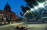 25 Sept 2009, Singapore --- ING Renault F1 Team driver Fernando Alonso of Spain drives past the Old Supreme Court building during first practice session at the Marina Bay street circuit for the Fia Formula One 2009 Singtel Singapore Grand Prix, the world's only street night race (Editors note: A special effects filter was used in the creation of this image). Photo by Victor Fraile --- Image by © Victor Fraile/Corbis