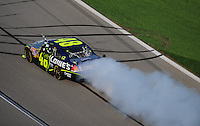 Sept. 28, 2008; Kansas City, KS, USA; Nascar Sprint Cup Series driver Jimmie Johnson celebrates after winning the Camping World RV 400 at Kansas Speedway. Mandatory Credit: Mark J. Rebilas-