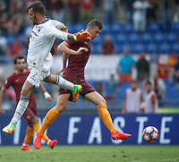 Calcio, Serie A: Roma vs Sampdoria. Roma, stadio Olimpico, 11 settembre 2016.<br /> Roma&rsquo;s Edin Dzeko, right, kicks to score during the Italian Serie A football match between Roma and Sampdoria at Rome's Olympic stadium, 11 September 2016. Roma won 3-2.<br /> UPDATE IMAGES PRESS/Isabella Bonotto