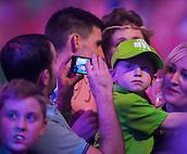29.12.2014.  London, England.  William Hill World Darts Championship.  Young Michael van Gerwen dart fan at the 2015 William Hill World Darts Championship.
