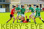 Gavin O'Grady Glenbeigh/Glencar  Stephen Roche and Donal Dennehy Milltown/Castlemaine  contest the loose ball during their IFC clash in Killorglin on Sunday