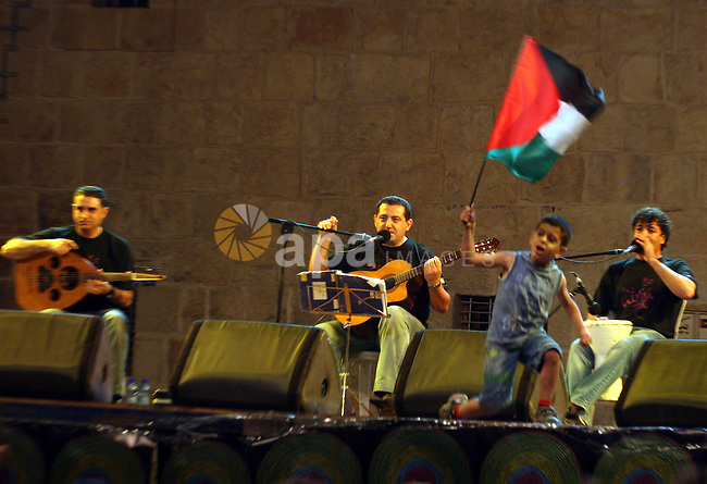 "Members of the Palestinian band music, from the city of Akka, perform during the festival ""Wayn ala Ramallah "" in the West Bank city of Ramallah on July 14, 2011. Photo by Issam Rimawi"