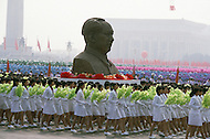 Beijing, China. October 1st, 1984. This huge parade is for the celebration of the 35th Anniversary of the Chinese Revolution. A float with a giant bust of the Great Leader, Mao Tse Tung.