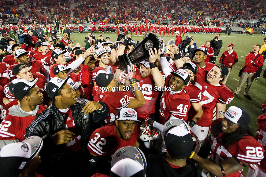 Wisconsin Badgers celebrate with the Leaders Division Trophy after an NCAA Big Ten Conference college football game against the Penn State Nittany Lions on November 26, 2011 in Madison, Wisconsin. The Badgers won 45-7. (Photo by David Stluka)