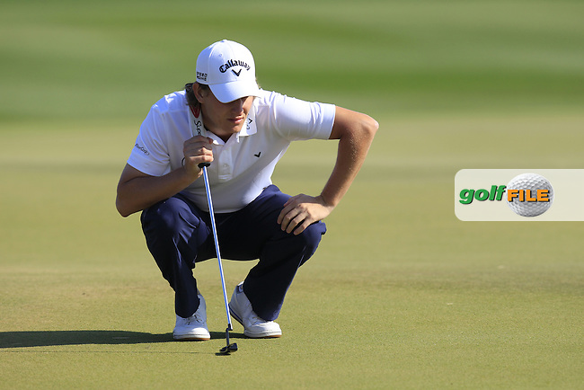Emiliano GRILLO (ARG) lines up his putt on the 9th green during Thursday's Round 2 of the 2015 Commercial Bank Qatar Masters held at Doha Golf Club, Doha, Qatar.: Picture Eoin Clarke, www.golffile.ie: 1/22/2015